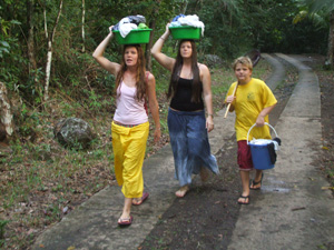 Carrying laundry from the stream in Guadaloupe