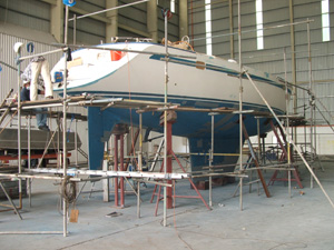 Faith, with no windows, hardware, or mast, stripped for work in Langkawi, Malaysia