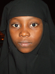 Just a beautiful girl in black headscarf and burqa