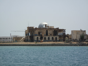 Bombed out structure standing over Massawa Harbour, Eritrea