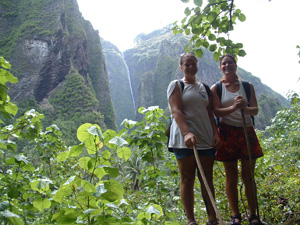 Emily and Amanda in front of Vaipo Waterfall, Nuku Hiva, French Polynesia